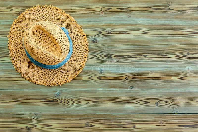 Rustic straw sunhat on old weathered pine royalty free stock photos