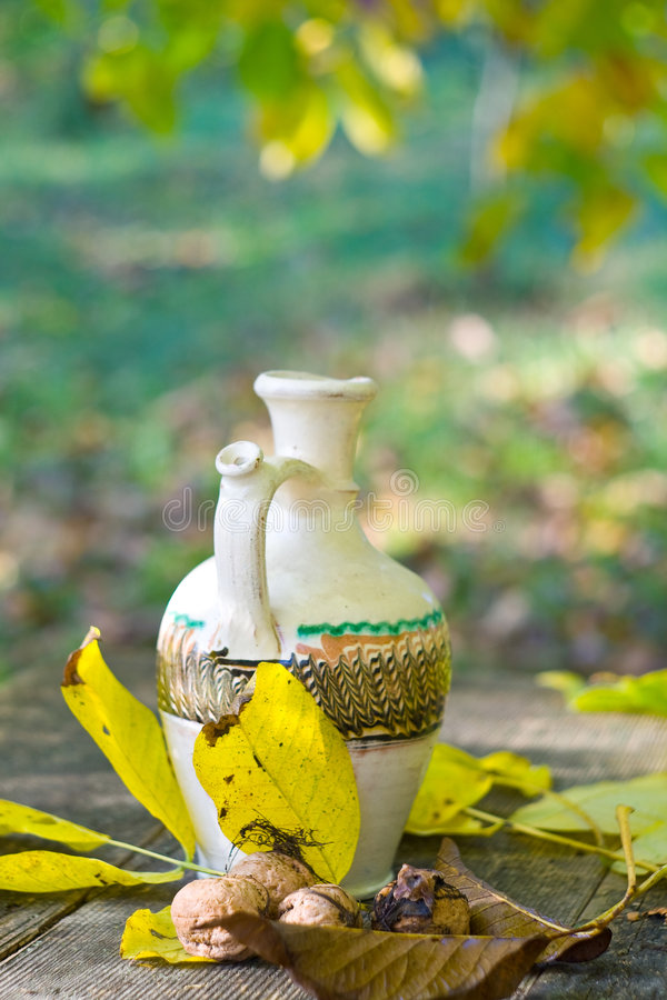 Free Rustic Table And Water Pot Royalty Free Stock Photo - 8401085