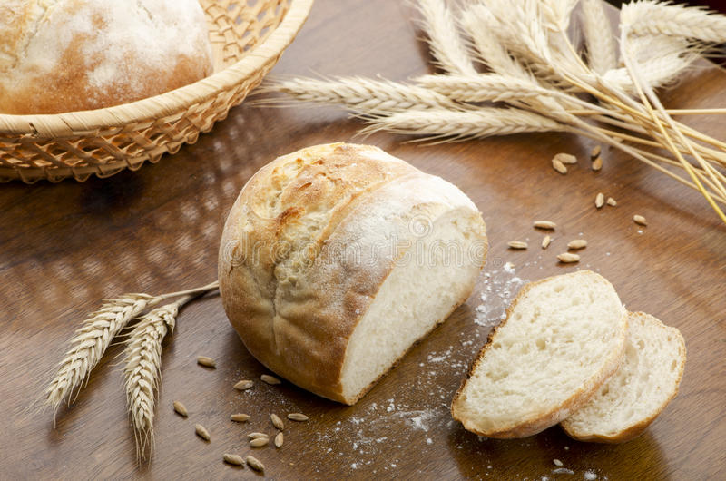 Rustic table with fresh bread royalty free stock photo