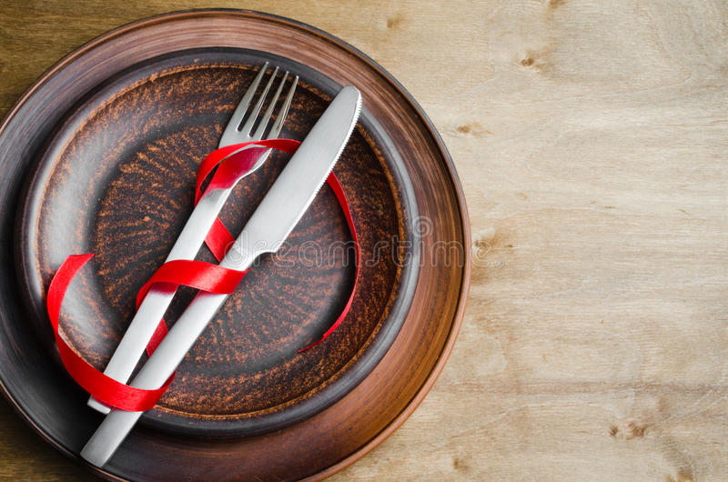 Rustic Table Setting for Christmas Eve or Valentine`s Day. royalty free stock photo
