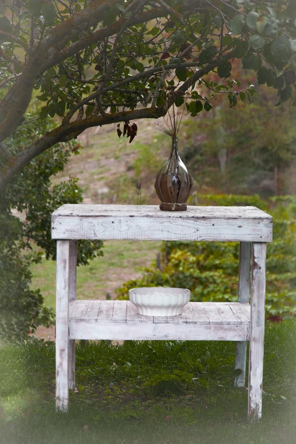 Rustic table under a tree royalty free stock image