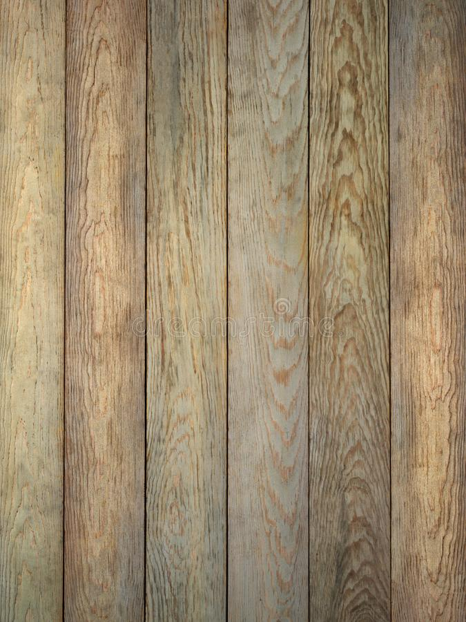 Rustic tan brown weathered barn wood board background. Rustic tan brown with grey weathered barn wood board surface showing rich grain royalty free stock photography