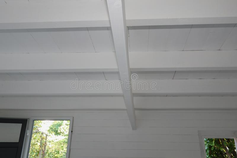 Rustic timber ceiling wood boards elements of construction of wooden roof stock photo