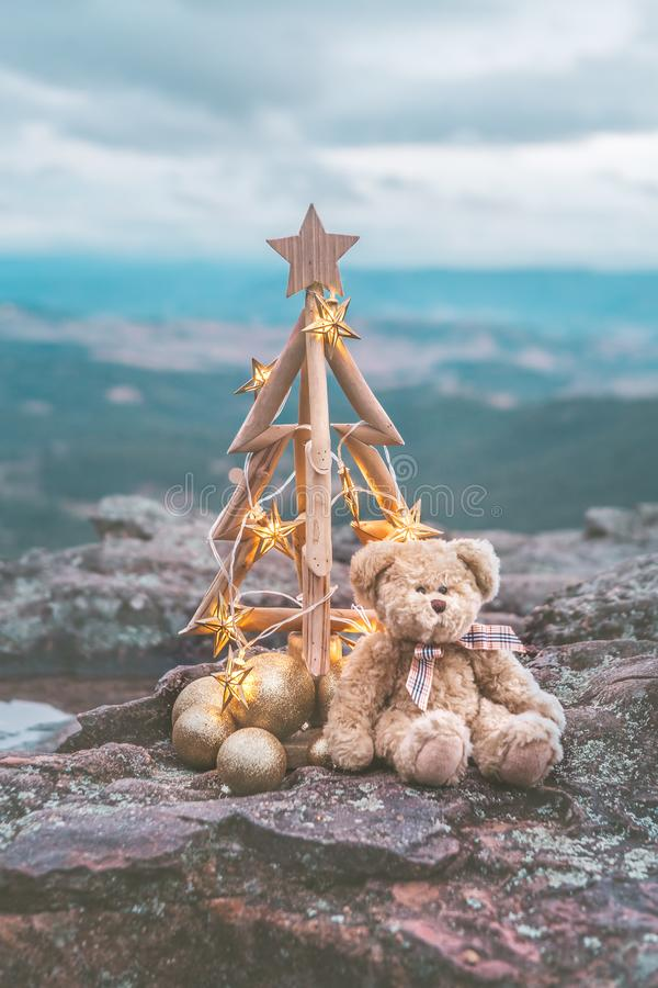 Christmas tree with golden star lights against mountain backdrop stock images