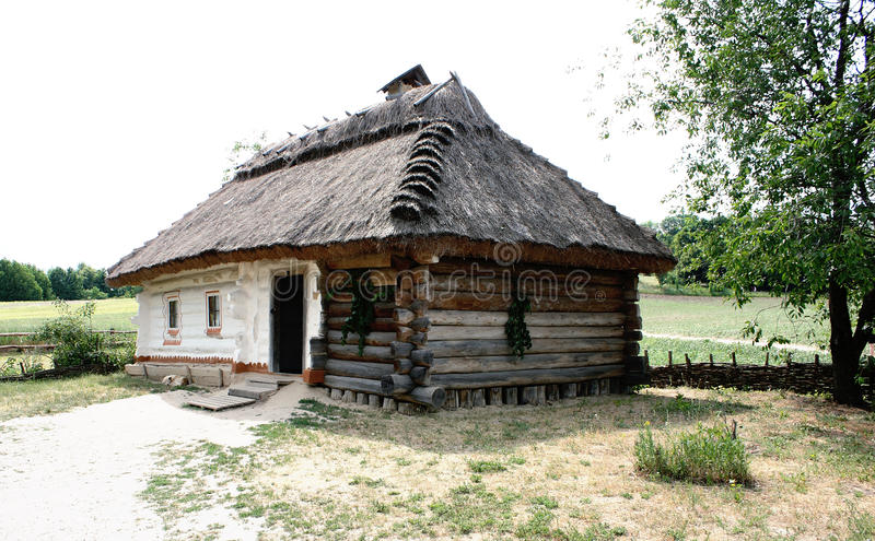 Rustic ukranian house. Surrounded by trees royalty free stock photography
