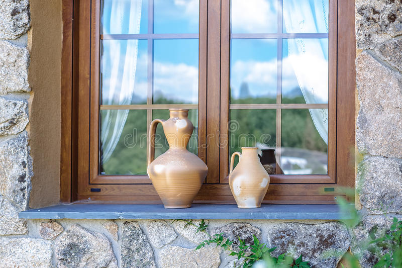 Rustic vases on window ledge. Outdoor design.  royalty free stock photos