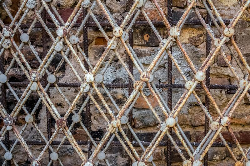Rustic, vintage, old metal fences stacked next to the wall.  royalty free stock photography