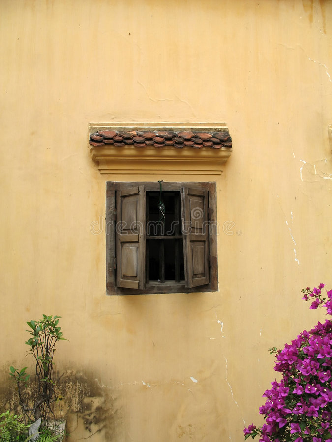Rustic wall with window, Hanoi, Vietnam royalty free stock images
