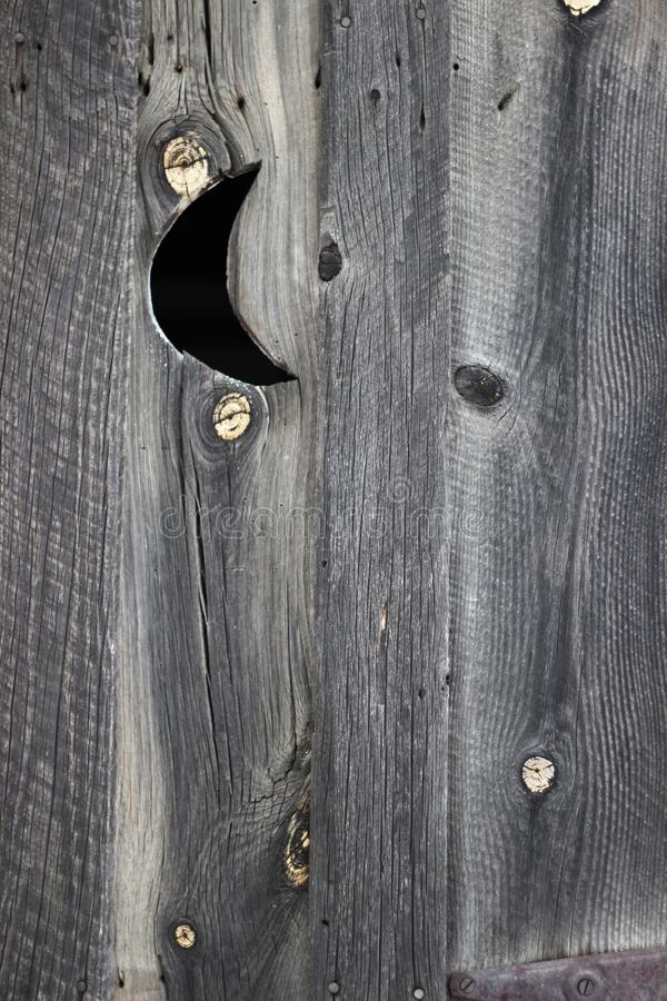 Rustic weathered wood outhouse door stock photos