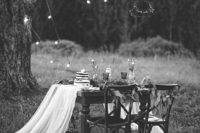 Rustic wedding ceremony in forest. Vintage decoration in forest. stock photos