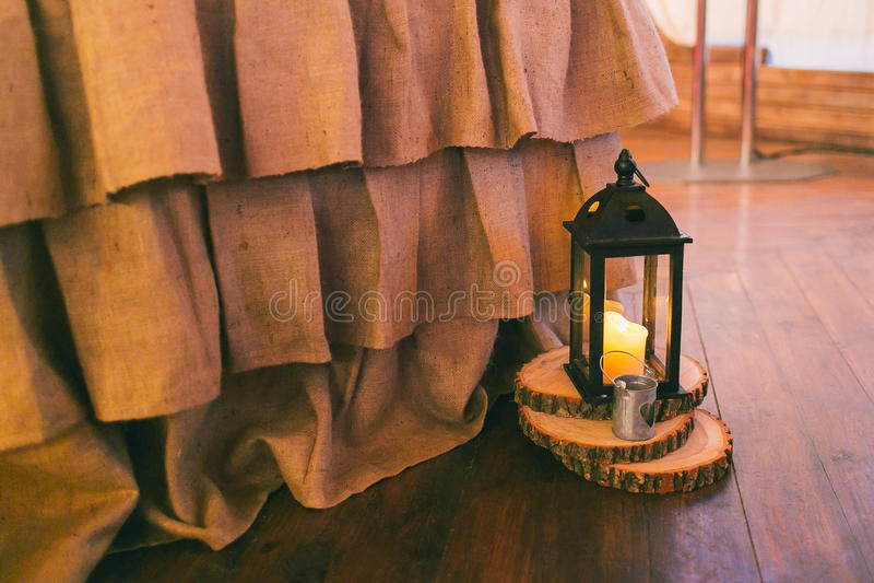 Rustic wedding decor, black lantern on the wooden mat stock photos