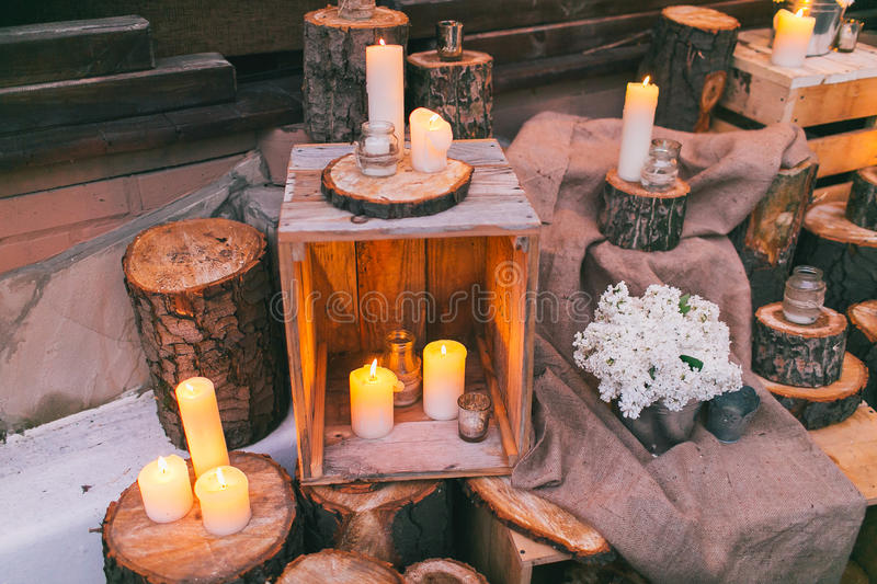 Rustic wedding decor, decorated box with candles on the stump stock image