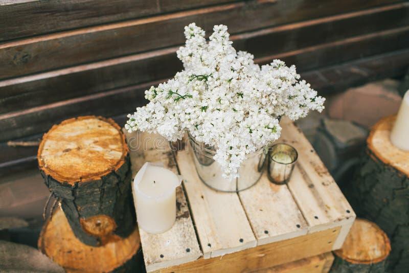 Rustic wedding decor, lilac arrangement on the box stock photos