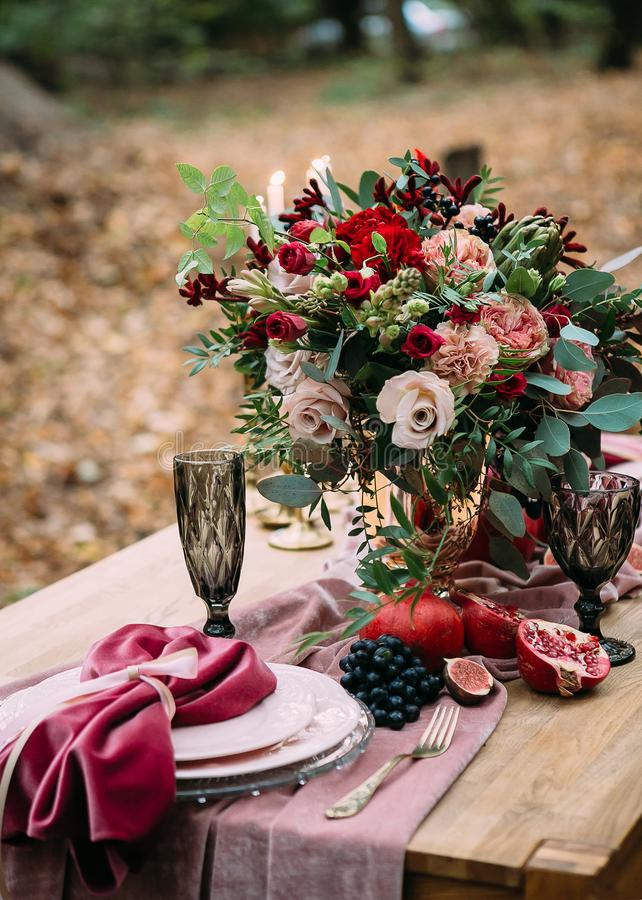 Rustic wedding decoration for festive table with beautiful flower composition. Autumn wedding. Artwork royalty free stock photo