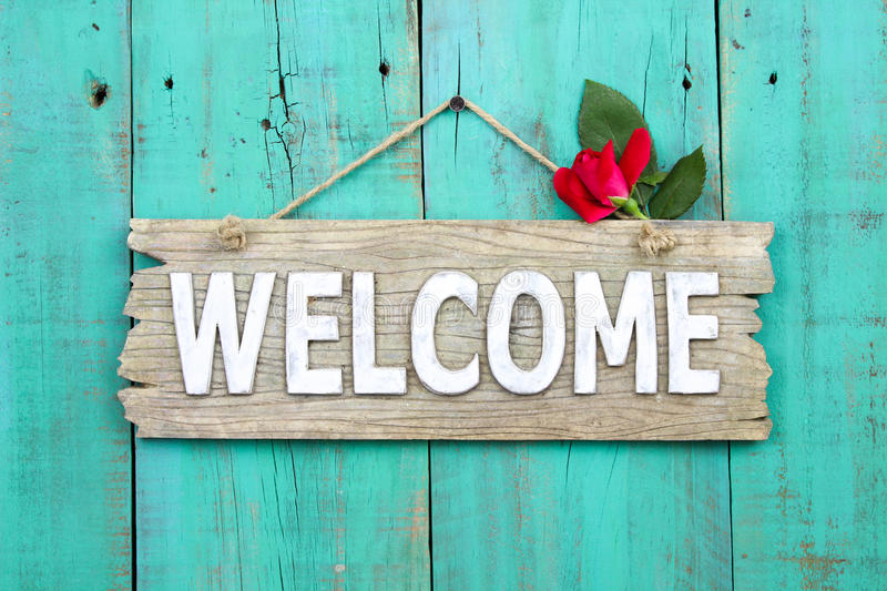 Download Rustic Welcome Sign With Red Flower Hanging On Distressed Antique Green Door Stock Image - Image of green, barn: 43915475