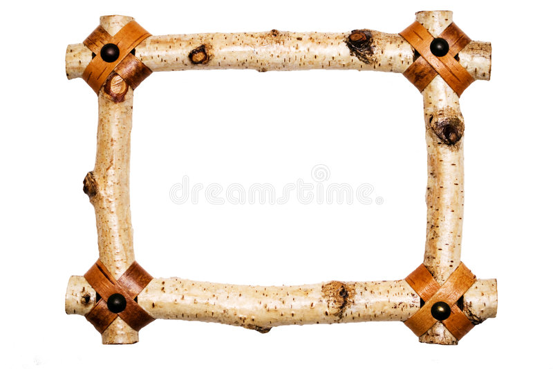 Rustic White Wood Frame. A rustic wood frame, made from tree branches, with details at the corners royalty free stock photos