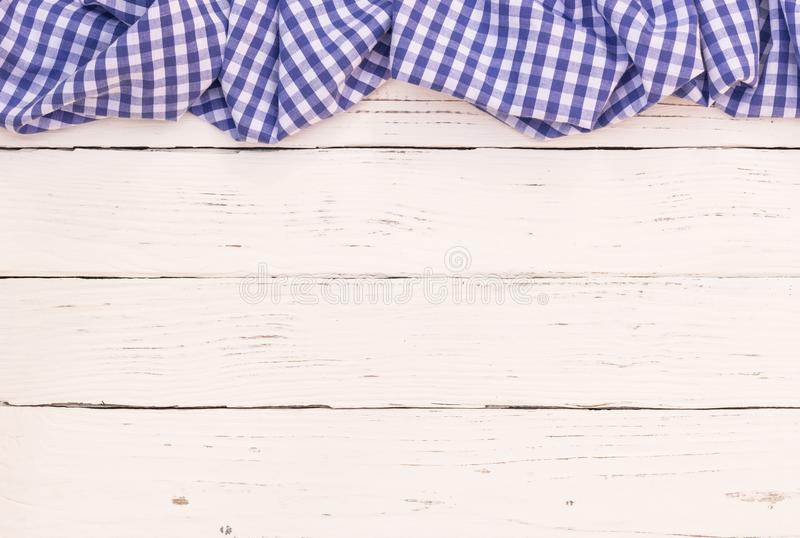 Blue tablecloth on white wood kitchen table background royalty free stock photos