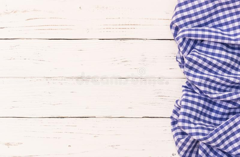 Vintage blue tablecloth on white table background, top view royalty free stock images