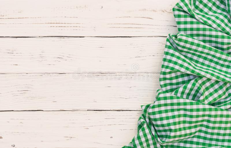 Easter background, white wooden table with green checked tablecloth and copy space royalty free stock photography