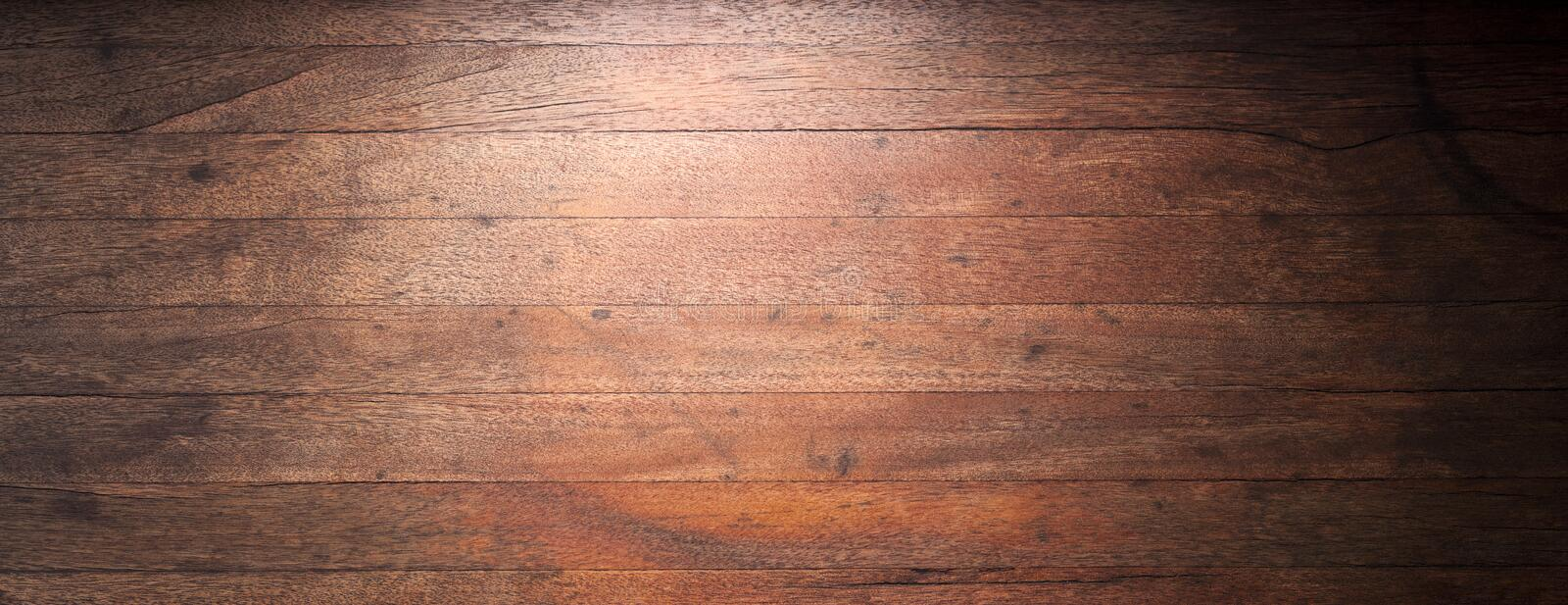 A Used Old And Worn Wood Banner Background With Gradated Lighting To Black
