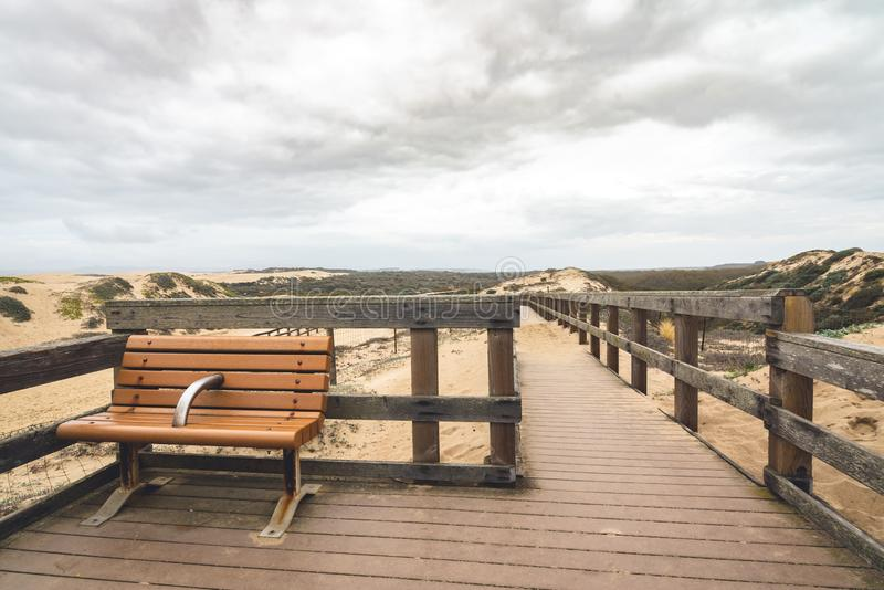 Rustic Wood Beach Boardwalk Through Sand Dunes. Oso Flaco Lake Natural Area State Park, California royalty free stock photos