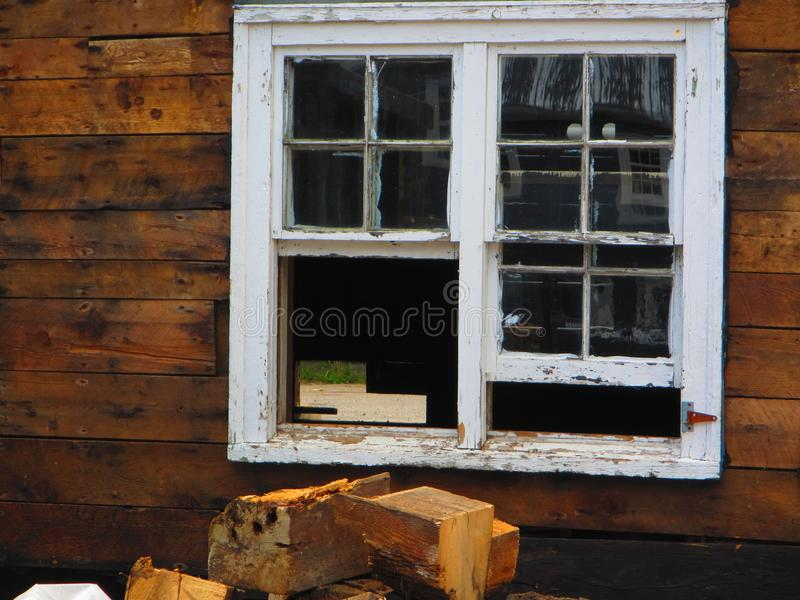 Rustic wood cabin with window royalty free stock photos