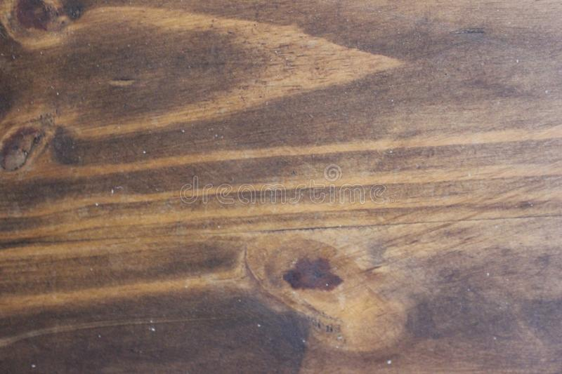 Rustic wood grain plank background. Patterned stained wood grain background royalty free stock photos