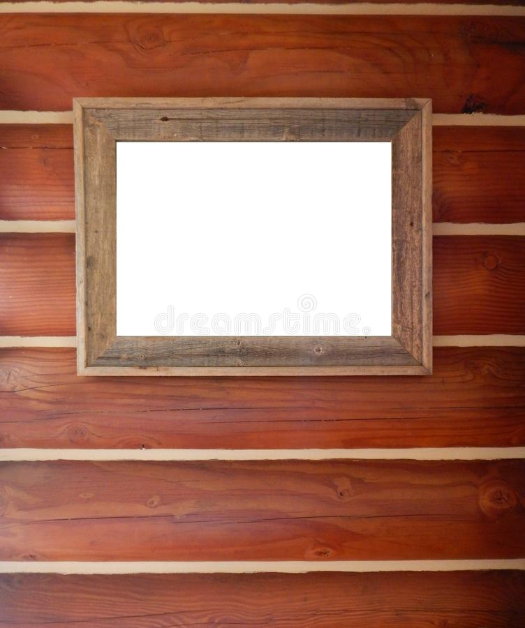 Rustic wood picture frame hanging on log wall. stock photos