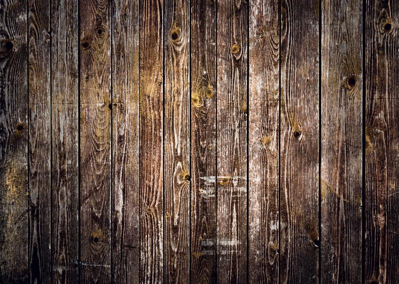 Rustic wood planks background with nice vignetting. Rustic wood planks background with nice studio lighting and elegant vignetting to draw the attention royalty free stock photo