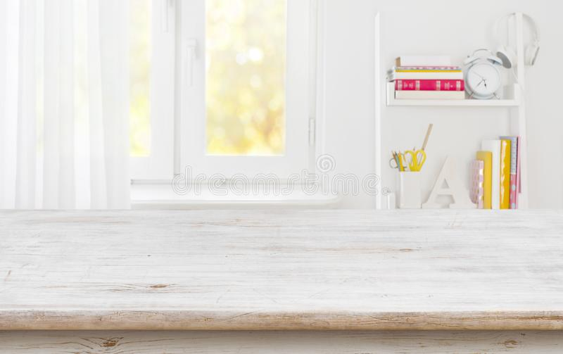 Rustic wood table for product display over blurred schooler room stock image