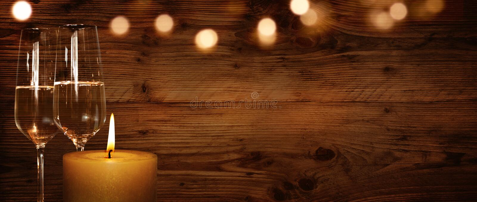 Rustic background with candle and champagne stock images