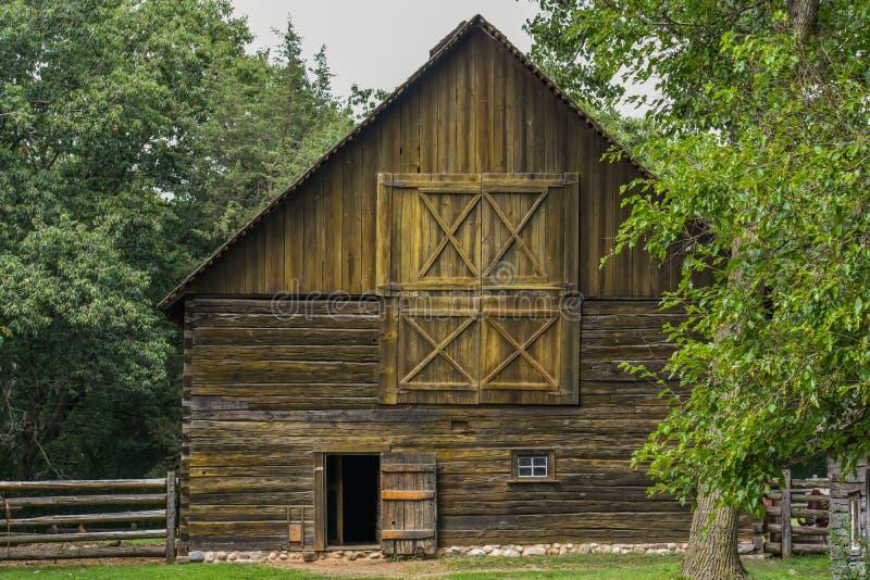 Rustic Wooden Barn with Open Door royalty free stock photos