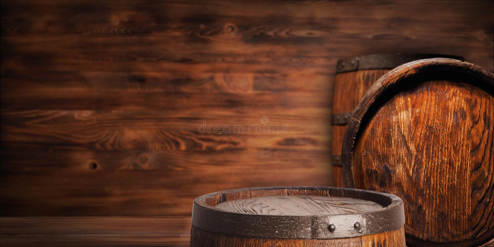 Rustic wooden barrel on a night background stock images