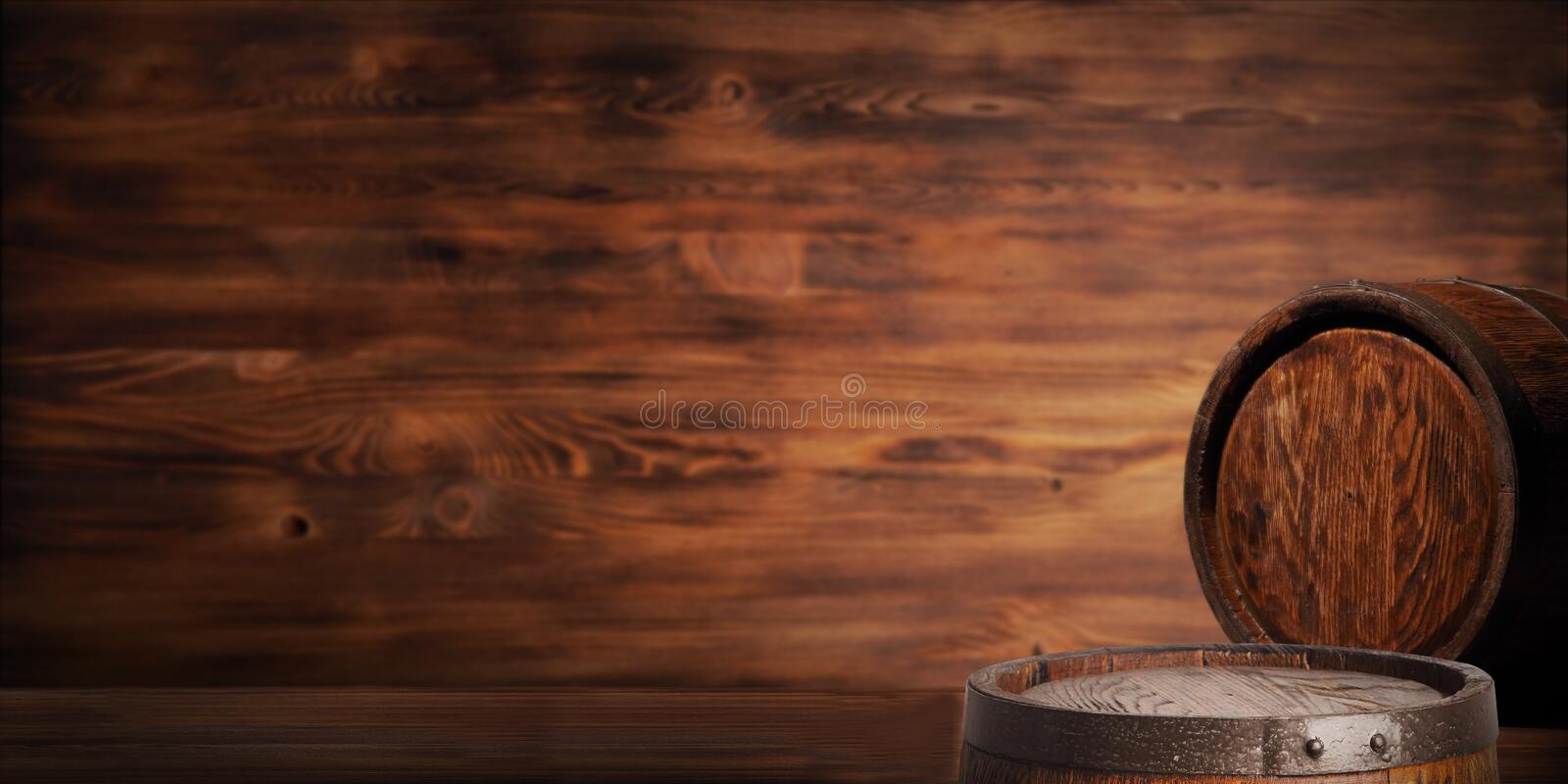 Rustic wooden barrel on a night background stock image