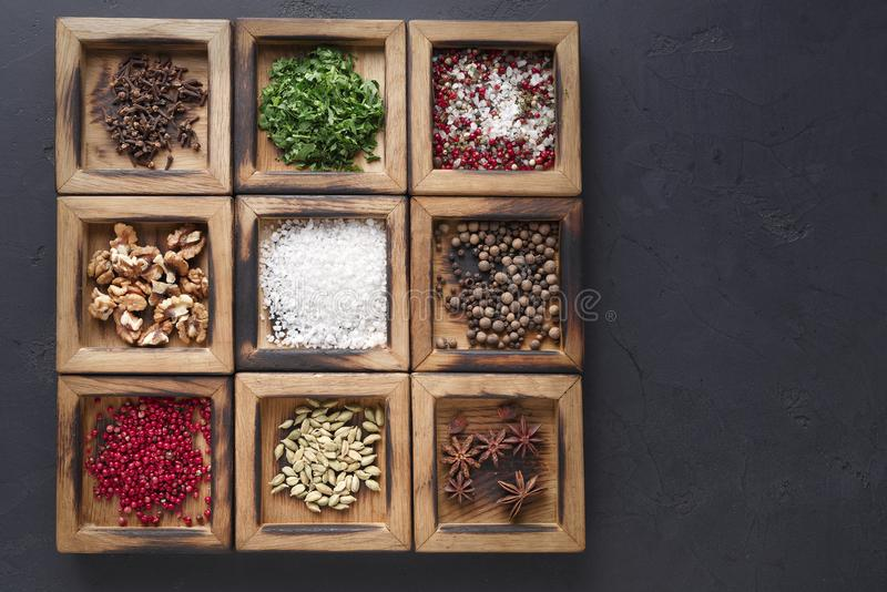 Variety of herbs and powder spices in a wooden box stock photo