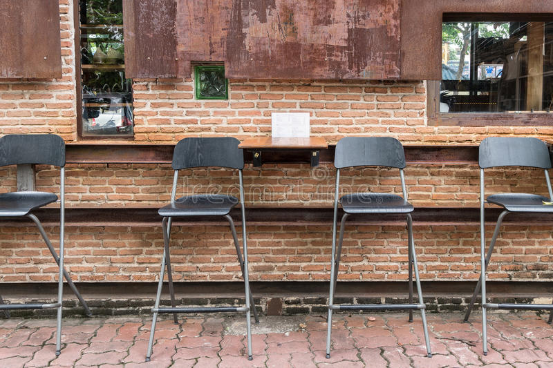 Rustic wooden chair outdoor cafe royalty free stock photography