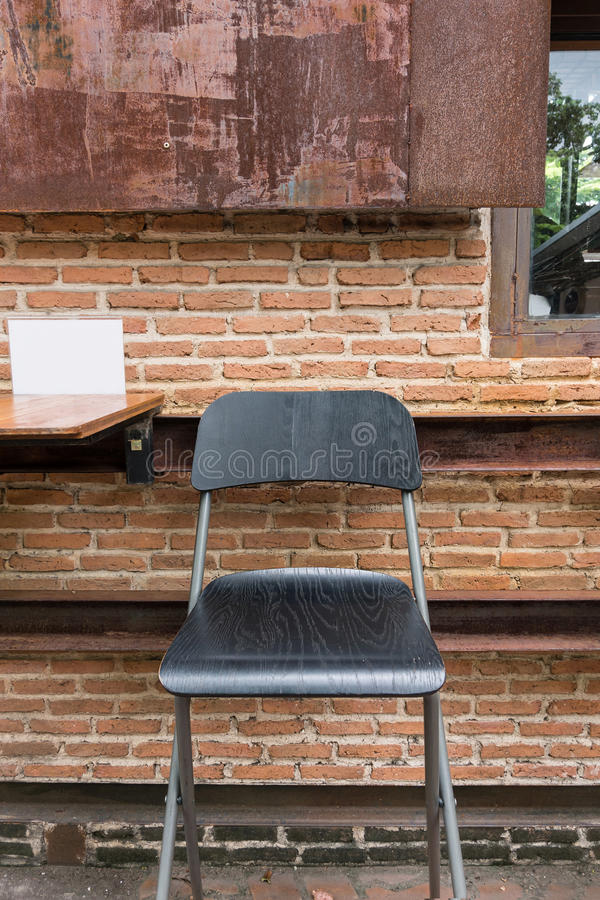 Rustic wooden chair outdoor cafe. Rustic wooden bar chair outdoor cafe stock photo