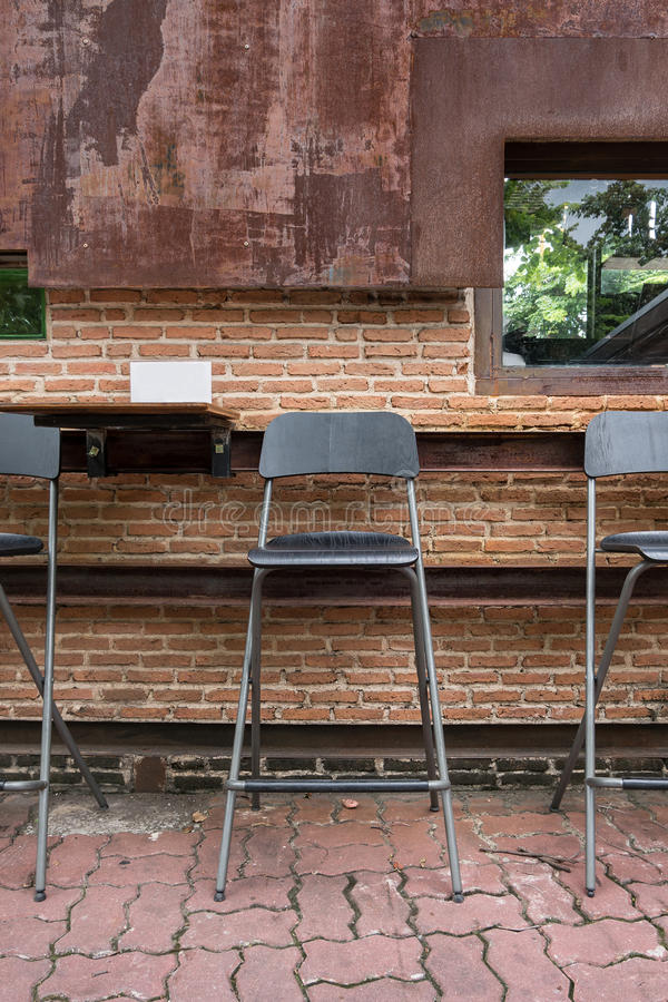 Rustic wooden chair outdoor cafe. Rustic wooden bar chair outdoor cafe stock image