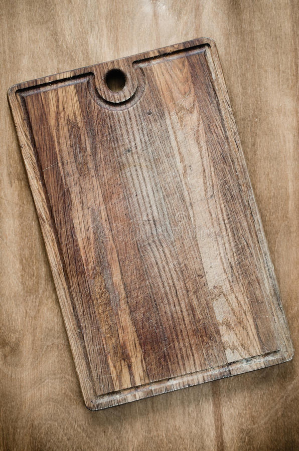 Rustic Wooden Cutting Board on Wooden Background. Wooden Cutting Board on Rustic Table For Kitchen Background. View From Above With Copy Space stock images