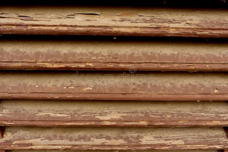 A rustic wooden fence or wall of pine shapes. Verticaly orientated stock photo