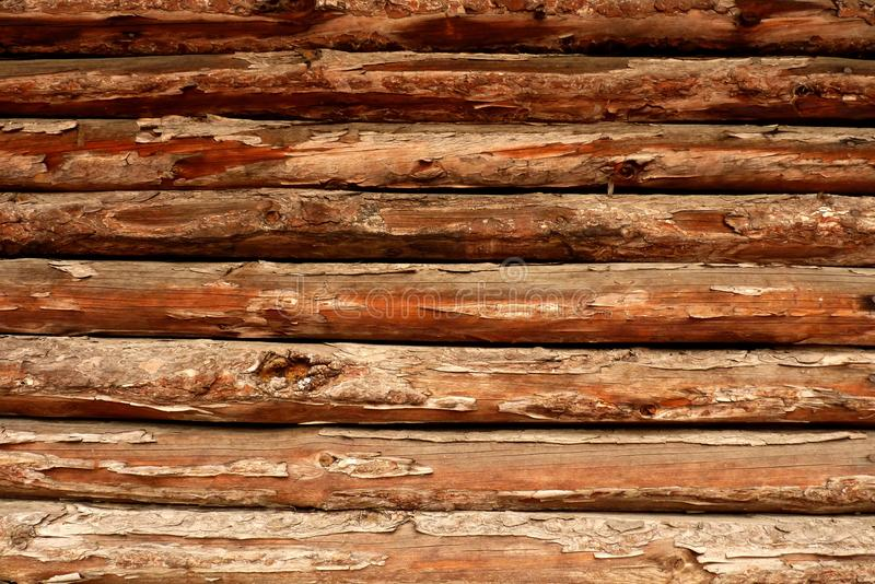 Wooden fence or wall of pine shapes. A rustic wooden fence or wall of pine shapes royalty free stock images
