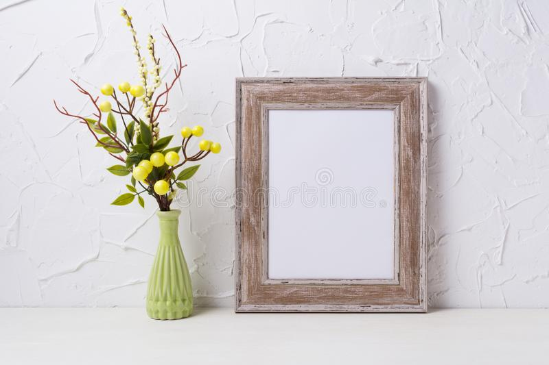 Rustic wooden frame mockup with green vase royalty free stock image