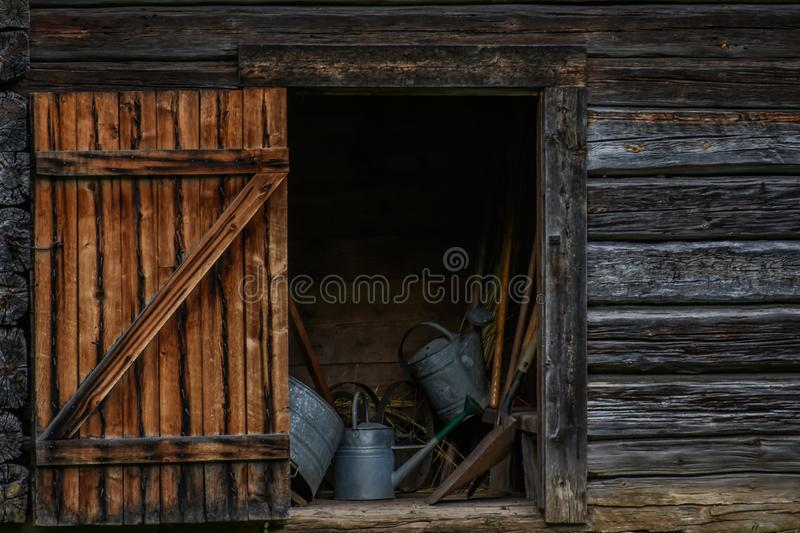 Rustic Wooden Shed with Open Door stock images