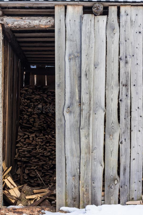 Village shed storing firewood for the winter royalty free stock photo