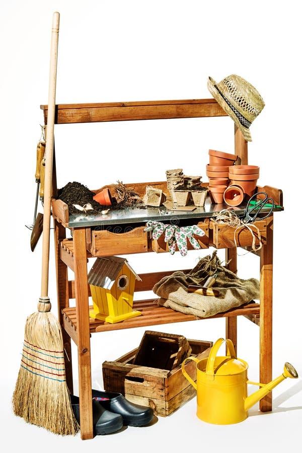 Rustic wooden shelves with garden supplies stock photo