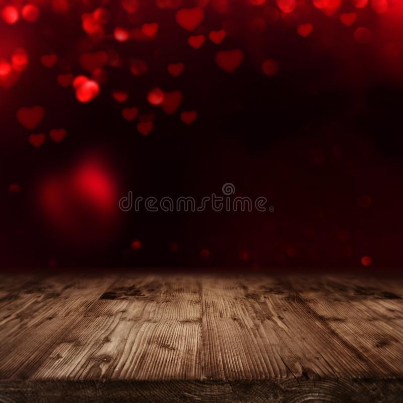 Valentines background with wooden stage. Rustic wooden stage in front of dark valentines background with red hearts royalty free stock image