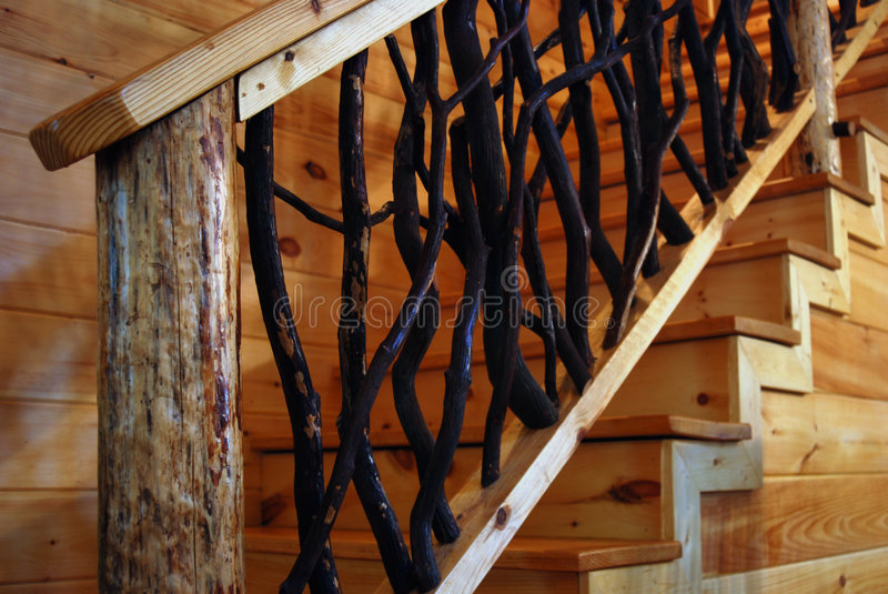 Rustic Wooden Staircase. A wooden staircase with branches and rustic wood in a cabin royalty free stock photos