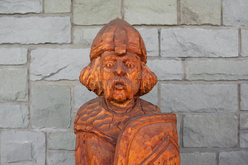 Rustic wooden statue of medieval warrior royalty free stock photos