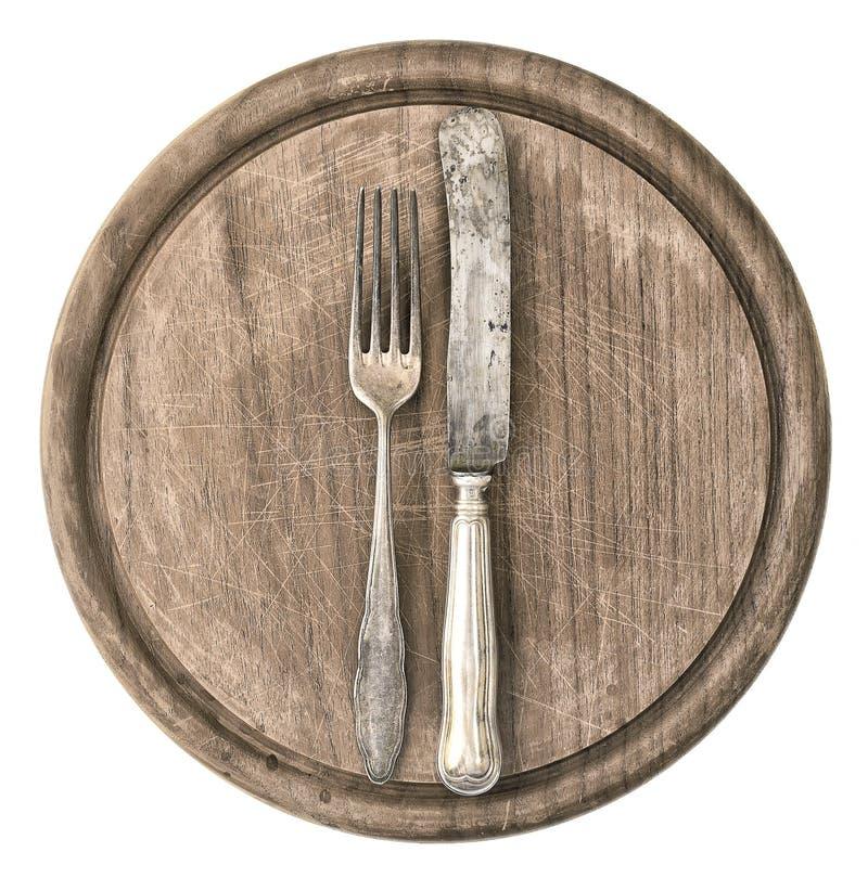 Rustieke houten raad met antieke mes en vork royalty-vrije stock afbeeldingen