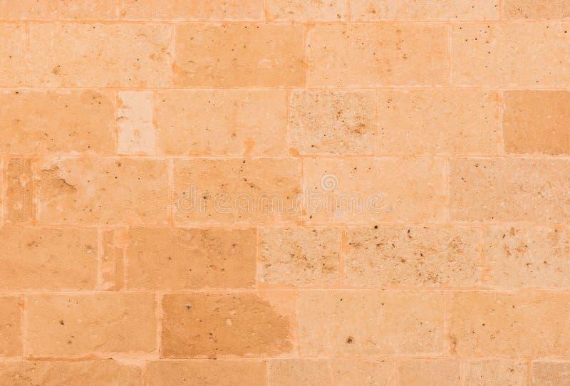 Rustikaler brauner Block formte Steinwandhintergrund lizenzfreie stockfotos